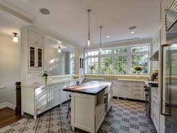 amazing white kitchen with pendant ligthing fixtures featuring
