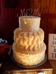 Rustic Ruffle And Rosettes Wedding Cake