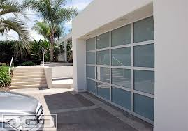 Glass Garage Doors in a Anodized Aluminum Frame & White Laminate