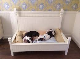 Four poster dog bed built to hold a baby crib mattress