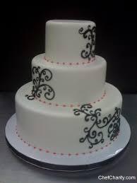 black scroll pink dot wedding cake