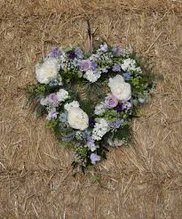Floral Heart On A Straw Wall Made From Blue Summer Flowers Cornflowers Nigella