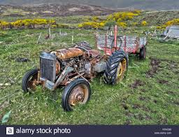 Old Massey Ferguson 135 Tractor In Abandonedstate With Trailer