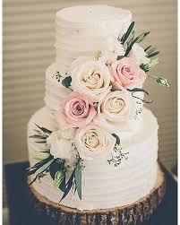 Rustic Wedding Cake Adorned With Blush Florals On Wood Slice Stand Weddingcake Rusticwedding Rusticweddingcake