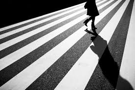Dramatic monochrome street photography that plays with light and