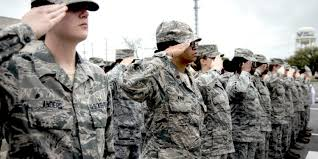 The All Female Formation Salutes During National Anthem At Base Retreat Ceremony March