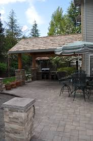 Patio Paver Ideas Houzz by Attached Roof With Paver Patio And Cultured Stone Columns By