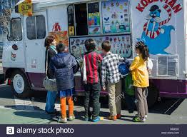 Customers Line Up To Buy Ice Cream From An Ice Cream Truck In ... Ice Cream Truck Santa Cruz Ca Multistop Truck Wikipedia Sale On Blue Stock Vector 2577630 Shutterstock Naked Filmmaking Kcrakeeping Cool With The Meltdown Grumman Olson Food Ccession For In Alabama Ford F250 Crittden Automotive Library Shaved And Kona Bread Delivery 1972 Good Humor Rare P10 Gmc Shorty Rat Rod All Treats Scored From Ranked Worst Used Bike For Icetrikes Bikes