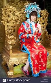 sitting in a golden throne has her photo taken wearing stock