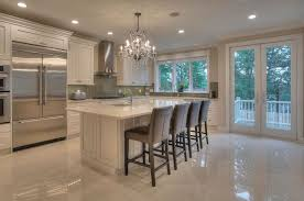 Luxury Kitchen With Cream Cabinets Marble Counter Island Flooring