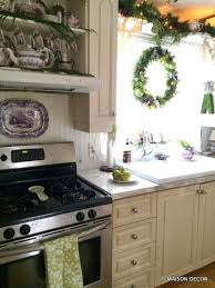 A Holiday Kitchen With Fresh Greens And Old Purple Dishes Moss Monogram From HomeGoods