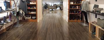 Tarkett Luxury Vinyl Floors Offer The Ultimate In Style And Performance Available Tiles With Or Without Grout Planks Adhered Floating