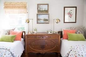 Small Country Guest Brown Floor And Dark Wood Bedroom Photo In New Orleans With Gray