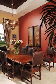 Dining Room With Multiple Earth Tones On Walls And Ceiling
