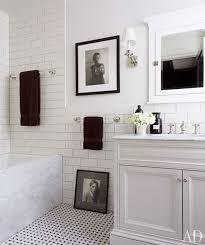 classic white black bathroom design with basketweave tiles via