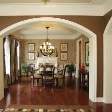 Neutral Traditional Dining Room With Dramatic Archway