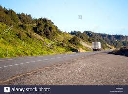 Classic Semi Truck With A Dry Van Trailer Leaves Into The Distance ...