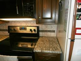 Kitchens With Dark Cabinets And Light Countertops by Santa Cecilia Light Granite Charlotte Granite Colors
