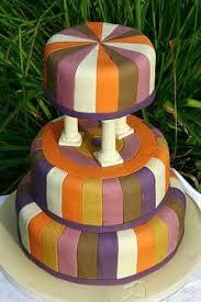 Three tier art deco white green purple orange and yellow wedding cake