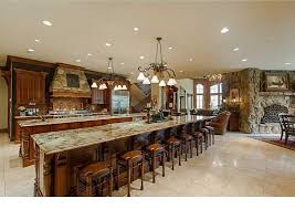 Inspiring Large Kitchen Island Idea With Ceiling Lighting And Seating