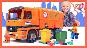 Garbage Truck BRUDER Mercedes-Benz Moves Garbage And Old Cars To ... The Top 15 Coolest Garbage Truck Toys For Sale In 2017 And Which Is Videos Children L Backyard Pick Up Bruder Mack Dump Truck Toy Awesome Bruder Mack Granite Rear Loading Garbage Buy Man Side Loading Orange Online For Toy Unboxing Compilation Nz Trucking Tga Magazine Cement Trucks Toys Prefer Orange Trucks Bruder Load By Fundamentally Backhoe Excavator Crane Granite Rear Red Green 116 Scale