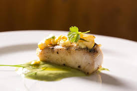 cuisine emulsion sea bass with coriander emulsion and cashew confit stock image