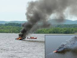 MAIN PHOTO Firefighters Aboard The Pembroke Fire Departments Water Rescue Boat Keep A Careful Eye On Blazing Off Shore From Marina