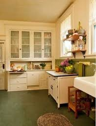 Green Marmoleum Flooring And Wainscot Lead The Eye To Original Cabinets Painted Ivory Focal Point Of Vintage Kitchen