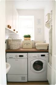 Tiny Laundry Room Idea Solid Shelf Over The Washer Dryer And Lots Of Cabinets