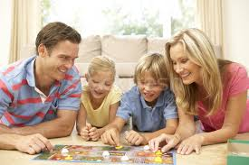 Stock Photo Family Playing Board Game At Home
