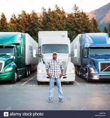 Black Man Truck Driver Near His Truck Parked In A Parking Lot At A ... Sacramento Portable Storage Units Moving Containers Tesla Semi Trucks Spotted Supercharging Near On Their Eagle Towing In Ca Youtube American Truck Simulator Transporting Frozen Vegetables From Custom Accsories Reno Carson City Folsom Commercial Drivers Learning Center Ca Hail Snow Storm 02262018