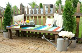 Creative IdeaSimple Brown Pallet Summer Outdoor Bench With Colorful Seats Also White Cushions Near