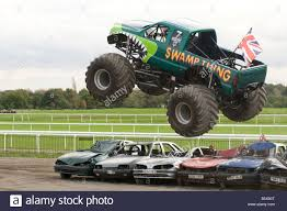 100 Truck Jump Monster Truck Jumping Over Crushed Cars In A Race Stock Photo