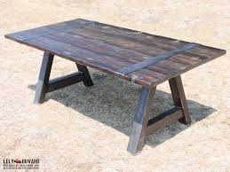 this dining table features a steel a frame base and metal straps
