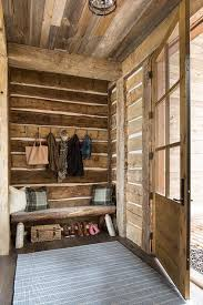 Country Style Mudroom With A Rustic Cabin Theme Features Wood Plank Walls And Built In Bench