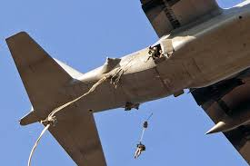 100 Exit C Paratroopers Exit A 130 Hercules Aircraft Over A Drop Zone