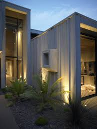 stunning house exterior with modern outdoor lighting and clear