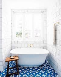 Blue Patterned Bathroom Floor Tiles Wooden Side Table White Free Standing Bathtuub Subway Tile Wall Towel