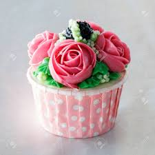 Beautiful Cupcake Decorated With Flower From Colorful Sweet Butter Cream Stock Photo