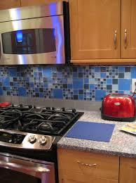 Kitchen Backsplash With Oak Cabinets by Blue Glass Backsplash Tile With Oak Cabinets And White Quartz