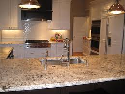 Kent Moore Cabinets Bryan Texas by Bianco Antico Granite Dark Island With White Perimeter Cabinets