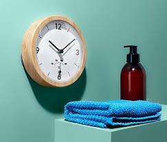 badwanduhr mit thermometer