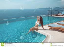 100 Infinity Swimming Model In White Bikini Sunbathing By Pool Stock