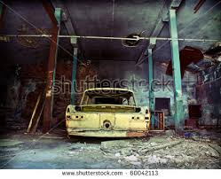Old Ruined Garage Interior With Car
