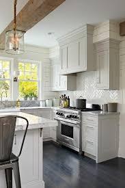 Light Gray Shaker Kitchen Cabinets With Glossy White Herringbone Tile Backsplash