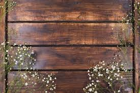 Light White Flowers On Wood