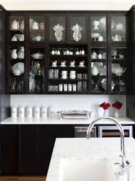At Home Arkansas Kitchen Black Cabinets Glass Doors Marble Counter
