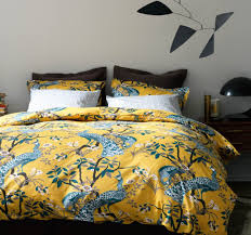 DwellStudio Peacock Duvet Set yellow and peacock blue bedding
