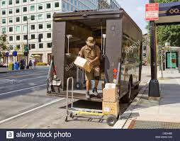 UPS Delivery Man Unloading Packages From Truck - Washington, DC USA ...