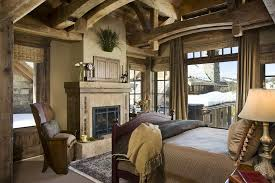 Rustic Guest Bedroom With Wood Frame Windows Neutral Carpet Stone Tile Fireplace